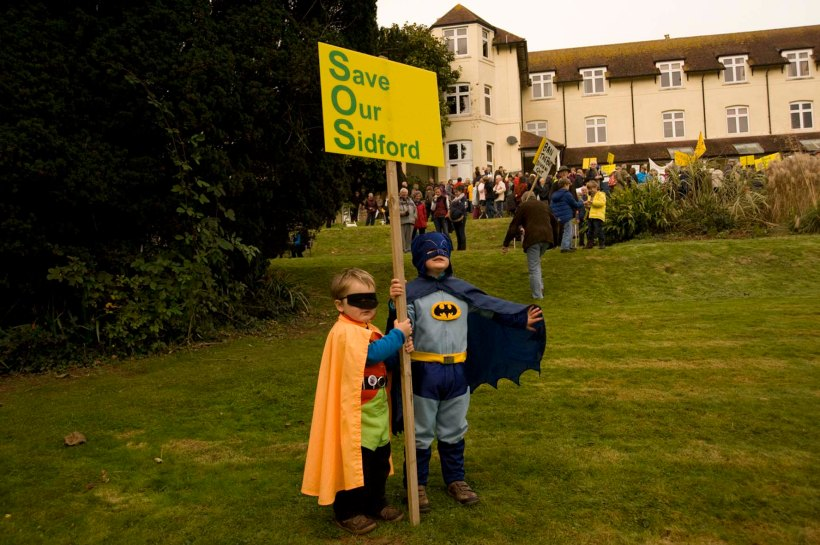 Batman and Robin (unmasked as Jake and Oscar) fly in to save the Knowle